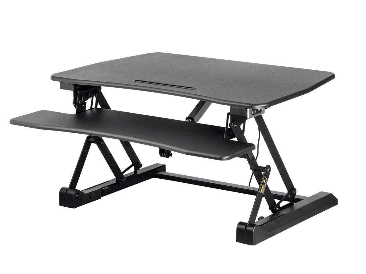 This Motorized Sit Stand Desk Converter Provides An Easy Height Adjule Solution The Electric Motor Does Heavy Lifting So Anyone Can Easily